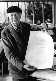 At home in Big Sur, showing his Nobel Peace Prize certificate, 1987