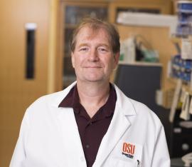 Dr. Adrian Gombart